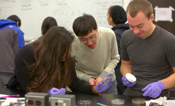 students and instructor in a lab