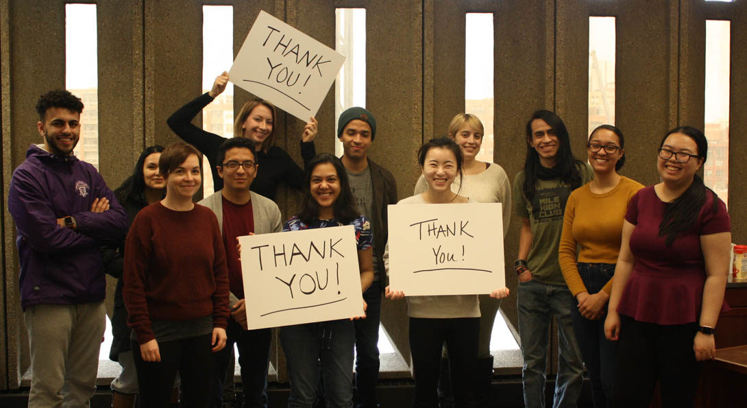Students with thank you signs